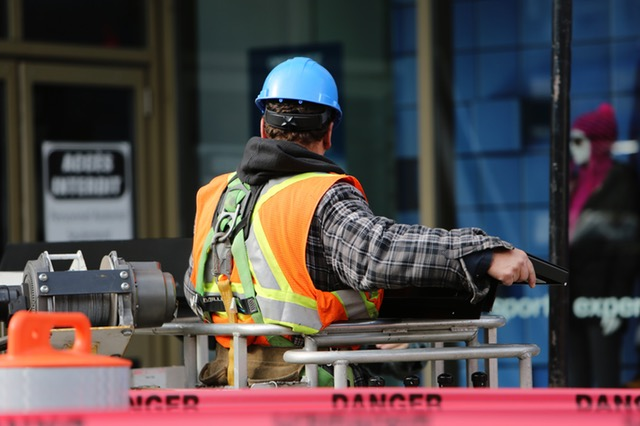 Career Opportunities: Image shows a construction worker wearing a safety vest and hard hat